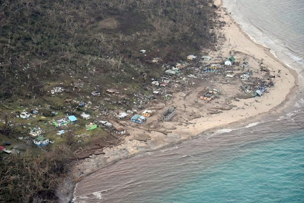 Image: A handout aerial picture taken by the Air New Zealand defense force shows the damage around Tavua on the main Fiji island of Viti Levu.