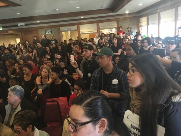 SFSU students and faculty at a community meeting with university president Les Wong discussing the budget and future of ethnic studies at SFSU.