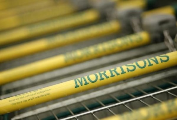 Shopping trolleys stand outside a Morrisons supermarket in Liverpool, northern England