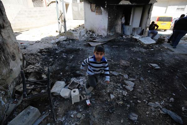 IMAGE: Palestinian boy in Qalandia debris
