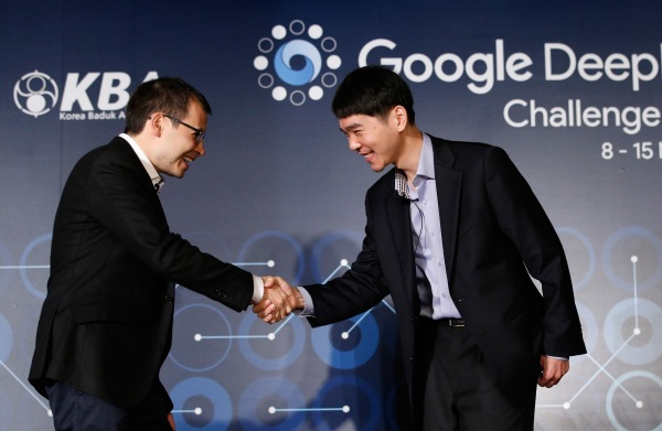 Image: South Korean professional Go player Lee Sedol, right, shakes hands with CEO of Google DeepMind Demis Hassabis