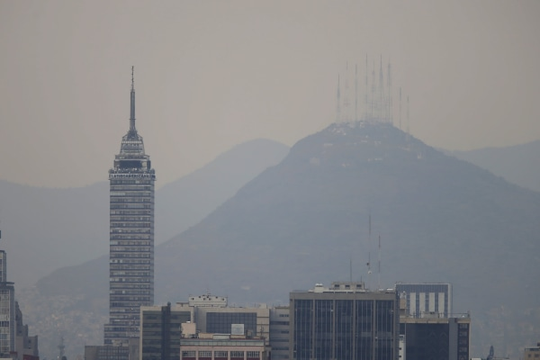 Image: Buildings stand shrouded in smog in Mexico City