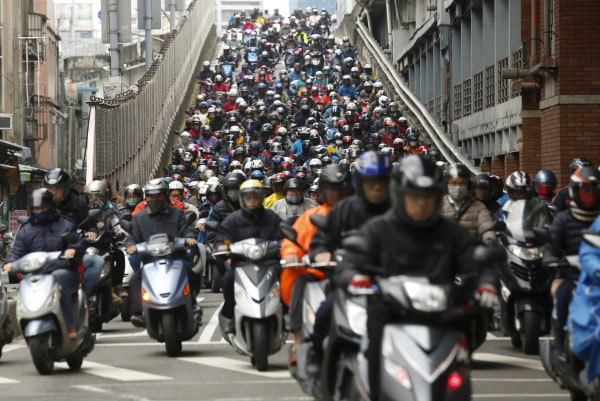 Image: Motorists ride to work on a bridge during morning rush hour in Taipei, Taiwan