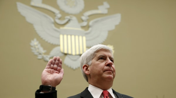 Image: Michigan Governor Rick Snyder is sworn in to testify for Flint Michigan water hearing on Capitol in Washington