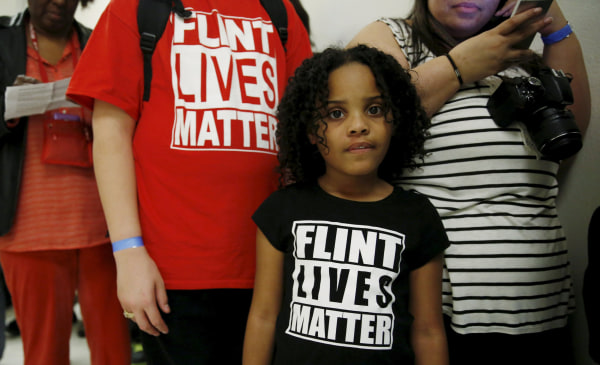 """Image: Flint Michigan residents wait in line for a House Oversight and government Reform hearing on """"Examining Federal Administration of the Safe Drinking Water Act in Flint"""