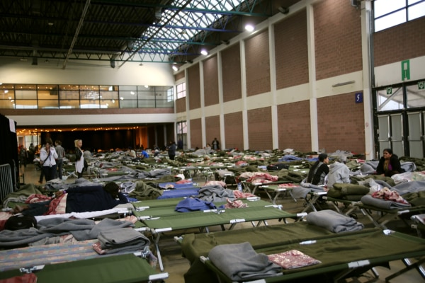 Image: makeshift shelter for passengers stranded by Brussels airport closure