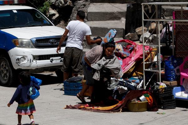 Residents gather their belongings while fleeing Las Torres neighbourhood.