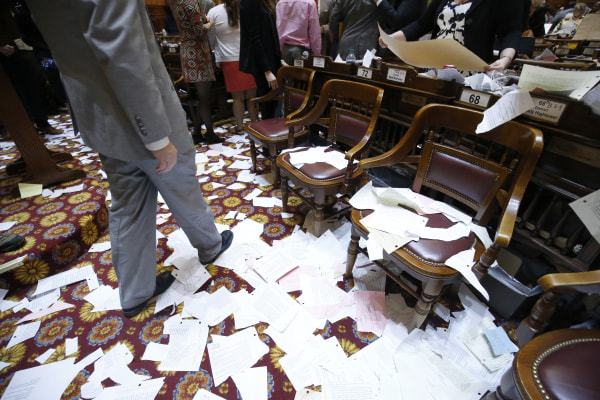 Paper litters the floor after the conclusion of the final day of the Georgia General Assembly at the capitol in Atlanta on Friday, March 25, 2016. (AP Photo/Jason Getz)