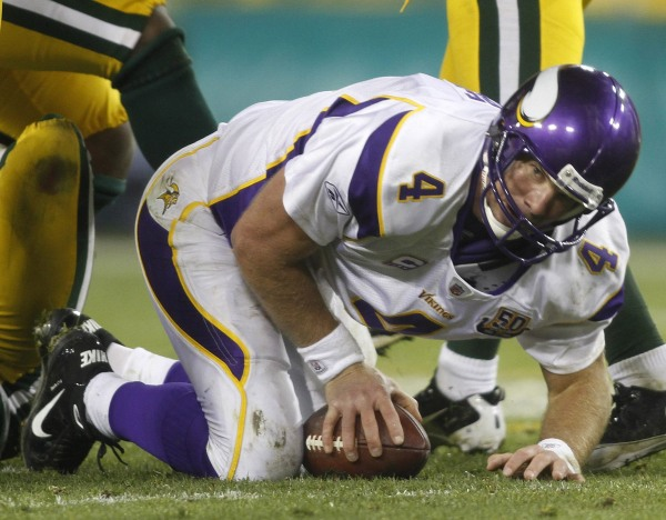Image: Minnesota Vikings quarterback Brett Favre is sacked by the Packers defense in Green Bay