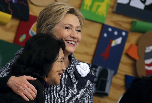 Image: Democratic U.S. Presidential candidate Hillary Clinton embraces Dolores Huerta, a labor leader as she attends a workshop meeting at La Casa The Resurrection Project, a immigrant community center, during a campaign stop in Chicago Illinois