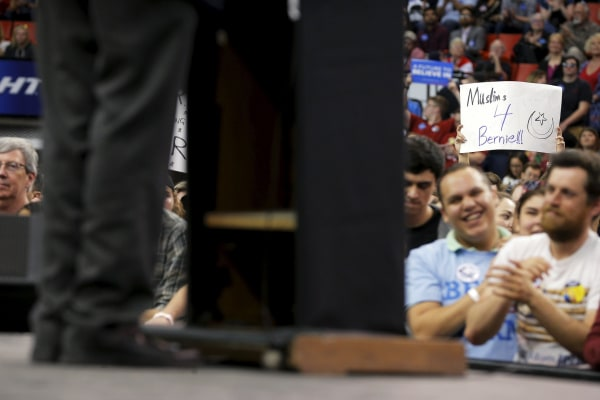 "Image: An audience member holds a ""Muslims 4 Bernie"" sign at a campaign rally with U.S. Democratic presidential candidate and U.S. Senator Bernie Sanders in Oklahoma City"