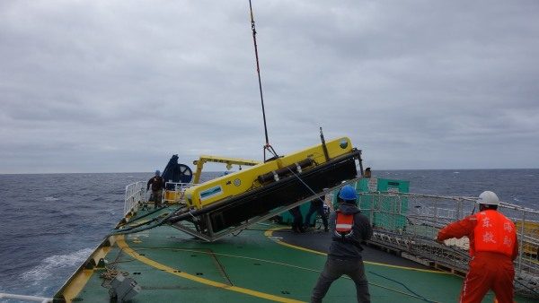 "Image: The lost ""towfish"" device was winched to the surface Monday."