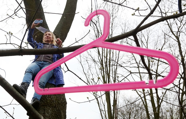 Image: A giant coat hanger in a tree during a protest in Warsaw, Poland, on April 9