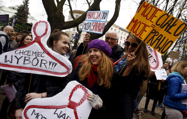 Image: People demonstrate against plans of tightening the abortion law in Warsaw