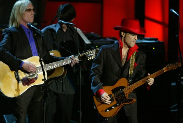 Image: Inductee Prince performing a song of George Harrison along with Tom Petty