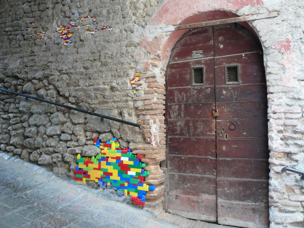 Image: Art installation on an old wall in Bocchignano, Italy