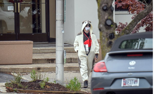 Image: A man claiming to be in possession of a bomb exits the Fox45 television station which was evacuated due to a bomb threat in Baltimore