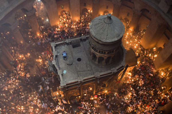 "Image: Orthodox Christian worshippers gather for the ""Holy Fire"" ceremony"