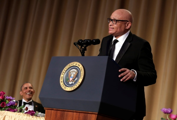 Image: President Barack Obama listens to comedian Larry Wilmore at the White House Correspondents' Association annual dinner
