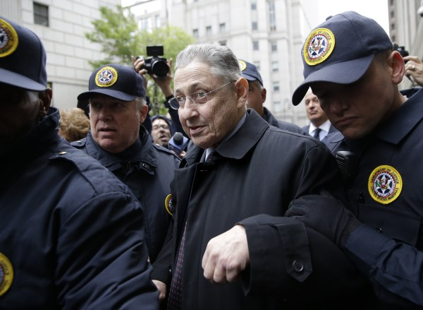 Image: Former Assembly Speaker Sheldon Silver leaves court surrounded by reporters