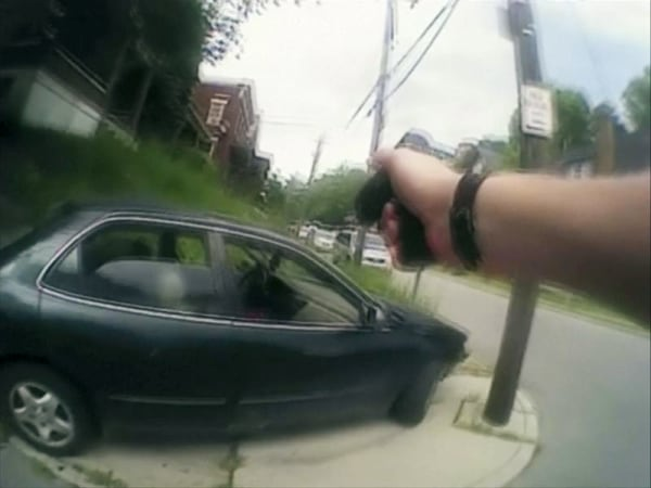 University of Cincinnati police officer Ray Tensing's body camera shows his handgun drawn in Cincinnati
