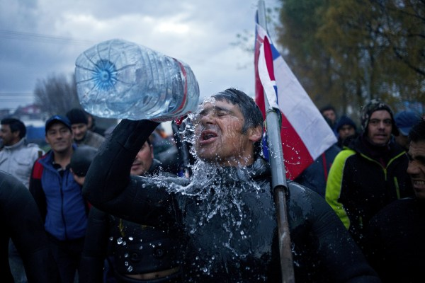 A diver throws water on his face during a protest march by shellfish divers in Chiloe Island, Chile.