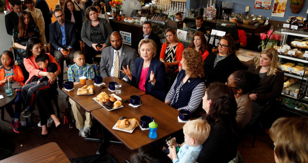 Image: Democratic presidential candidate Hillary Clinton holds a discussion with women and families on work-life balance and family issues during a visit to a cafe in Stone Ridge