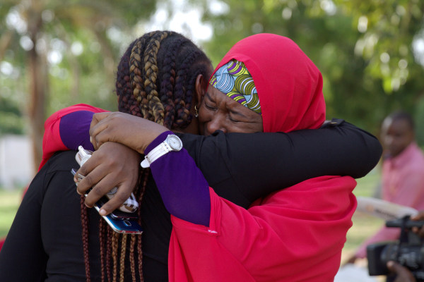 Image: Members of the #BringBackOurGirls campaign embrace each other at a sit-out in Abuja, Nigeria