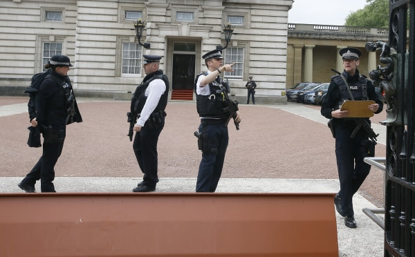Image: Armed police officers work at the main gate of Buckingham Palace in London, Thursday, after a man climber over a wall.