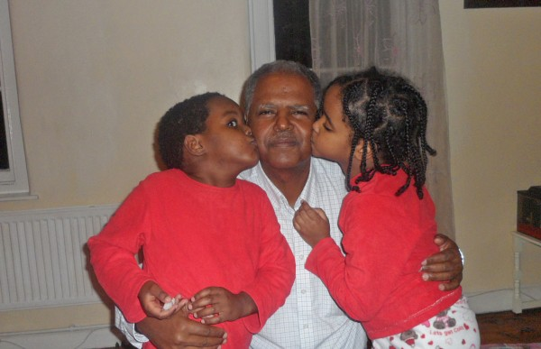 Image: Andy Tsege with twins Menabe and Yilak