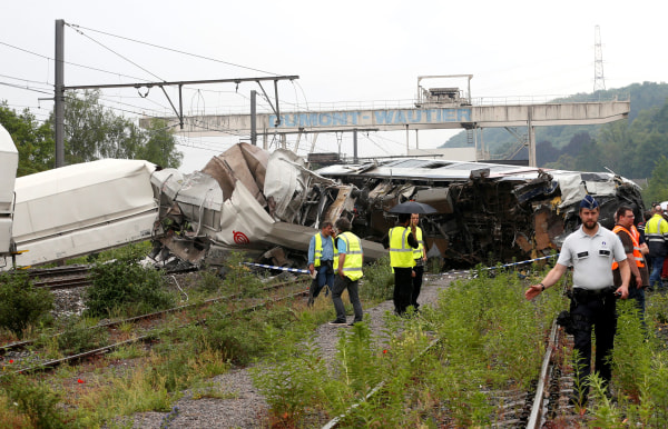 Image: The wreckage of a passenger train is pictured after it crashed into the back of a freight train in the eastern Belgian municipality of Saint-Georges-Sur-Meuse