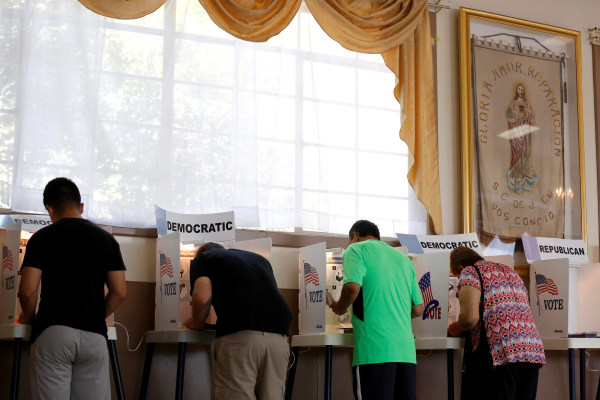 Image: People vote at Assumption Church during the U.S. Presidential Primary Election in Los Angeles