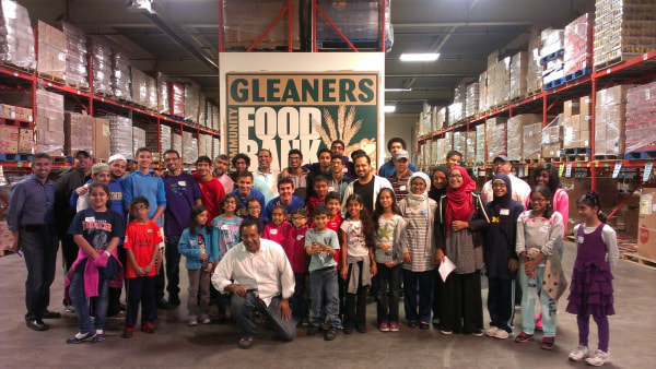 Michigan Muslim Community Council (MMCC) Ramadan Fight against Hunger campaign volunteers sorting food at Gleaners Food Bank, Detroit, Michigan, 2015.
