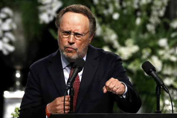 Image: Actor Billy Crystal speaks at a memorial service for the late boxer Muhammad Ali in Louisville, Kentucky