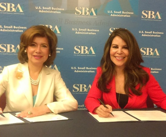 Mar?a Contreras-Sweet (l) and Nely Gal?n at ceremonial agreement signing, June 13, 2016, Washington, D.C.