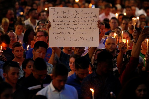 Image: Candlelit memorial service for victims of Pulse massacre