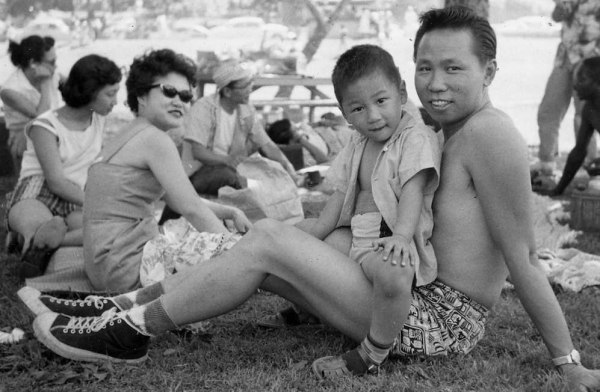 Ray Kwong (center) with his father and mother.