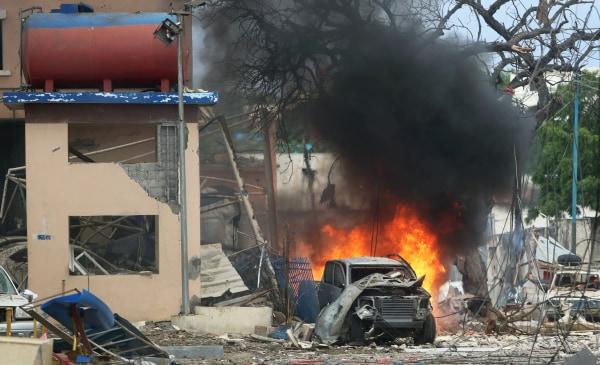 Image: A vehicle burns at the scene of a suicide bomb attack outside Nasahablood hotel in Somalia's capital Mogadishu