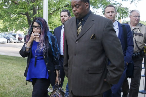 Image: Tyka Nelson, left, the sister of the Prince, arrives at the Carver County courthouse in Chaska, Minn.on June 27, 2016 with her husband, Maurice Phillips