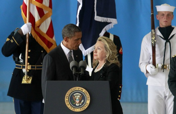 President Barack Obama and then-Secretary of State Hillary Clinton deliver remarks during a transfer ceremony of the remains of U.S. Ambassador Chris Stevens and three other Americans killed in Benghazi at Andrews Air Force Base on September 14, 2012.