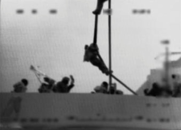 Image: An Israeli marine is dropped from a helicopter onto the Gaza-bound ship