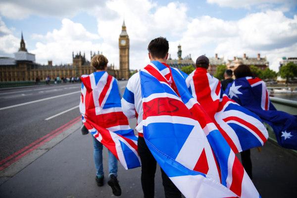Image: People walk over Westminster Bridge