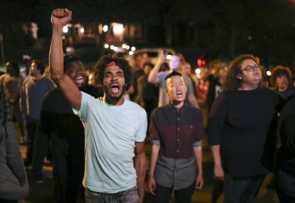 Image: Angry demonstrators chant as they block Summit Ave