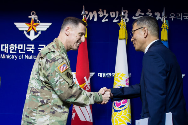 Image: South Korean Defense Ministry's Deputy Minister Yoo Jeh-seung shakes hands with the commander of U.S. Forces Korea