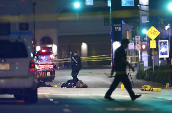 Image: Police investigatethe scene of Thursday's fatal shooting