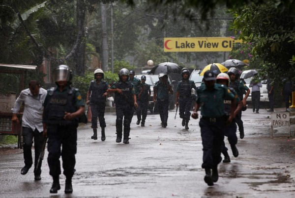 Image: Policemen patrol on the road leading to the Holey Artisan Bakery and the O'Kitchen Restaurant after gunmen attacked, in Dhaka