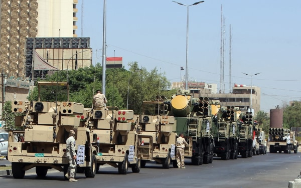 Image: Iraqi pro-government forces take part in a rehearsal for a military parade in the streets of Baghdad