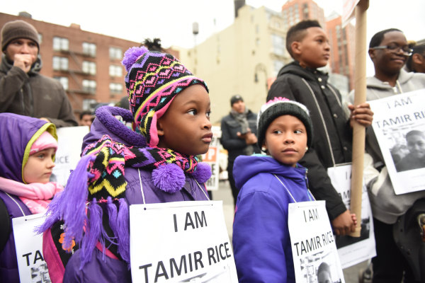 Kids with Tamir Rice signs. Stop Mass Incarcerations Network