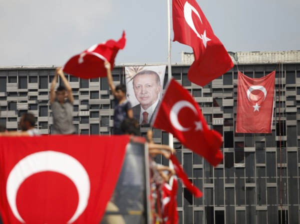 Image: A portrait of Turkish President Erdogan hangs on a building in Istanbul