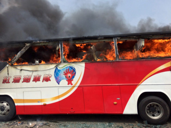 Image: Taiwan tourist coach catches fire, killing 24 Chinese tourists and Taiwan guide and driver